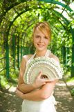 Smiling redhead girl. With a bouquet of white roses Stock Photos