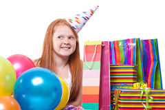 Smiling redhead  girl with balloons and gift box Stock Photo