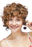 Smiling redhead girl with cherry Royalty Free Stock Images