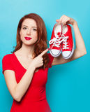 Smiling redhead girl with gumshoes Stock Photo
