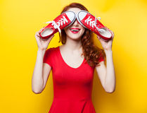 Smiling redhead girl with gumshoes Stock Photography