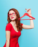 Smiling redhead girl with hanger Stock Image