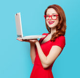 Smiling redhead girl with laptop Stock Photography
