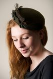 Smiling redhead in green hat with bow Royalty Free Stock Photos