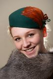 Smiling redhead in green hat and fur Royalty Free Stock Photo