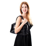 Smiling redhead with handbag Stock Photos