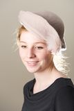 Smiling redhead in taupe hat looking down Royalty Free Stock Image