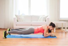 Smiling Redhead Teenage Girl Doing Plank At Home Stock Photos