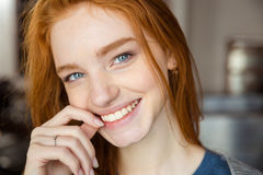 Smiling redhead woman looking at camera Stock Image