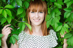 Smiling redhead woman Stock Photos