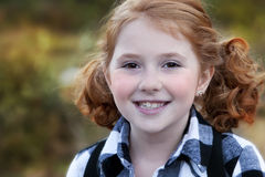 Smiling Redheaded girl with pigtails Stock Photos