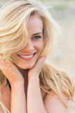 Smiling relaxed blond looking away at beach Royalty Free Stock Photo
