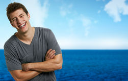 Smiling relaxed man at the beach in a summer day Royalty Free Stock Image