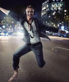 Smiling relaxed man dancing in a downtown Stock Images