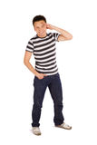 Smiling Relaxed Man Saluting Stock Photo