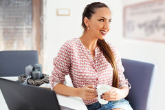 Smiling relaxed woman drinking tea and dreaming Royalty Free Stock Photography