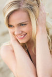 Smiling relaxed young blond looking away at beach Royalty Free Stock Photos