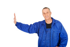 Smiling repairman against the wall Stock Photo