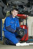 Smiling repairman auto mechanic Stock Images