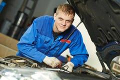 Smiling repairman auto mechanic Stock Photos