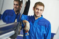 Smiling repairman auto mechanic Royalty Free Stock Images
