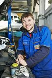 Smiling repairman auto mechanic Stock Photos