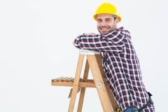 Smiling repairman climbing ladder Royalty Free Stock Photos