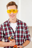 Smiling repairman with a dril Stock Photo
