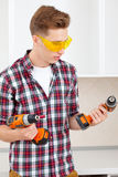 Smiling repairman with a dril Stock Image