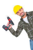 Smiling repairman with drill machine Royalty Free Stock Image