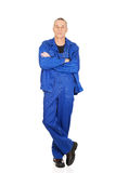 Smiling repairman with folded arms Stock Photo