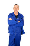 Smiling repairman with folded arms Stock Photography