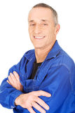Smiling repairman with folded arms Stock Images