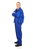 Smiling repairman with folded arms Stock Image