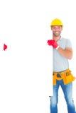 Smiling repairman holding blank billboard Royalty Free Stock Image