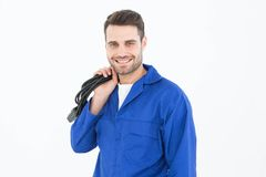 Smiling repairman holding cable Royalty Free Stock Images