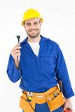 Smiling repairman holding electric plug Royalty Free Stock Image