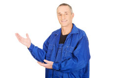 Smiling repairman showing copy space Royalty Free Stock Image