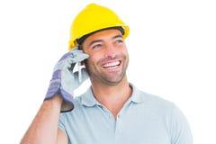 Smiling repairman talking on mobile phone Stock Photos