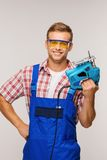 Smiling repairman with tool Stock Photo