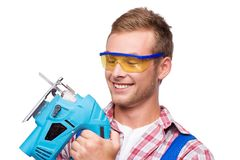 Smiling repairman with tool Royalty Free Stock Photos