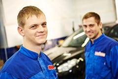 Smiling repairmen auto mechanic Stock Photos