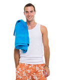 Smiling resting on vacation guy with towel Stock Images