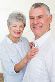 Smiling retired couple looking at camera Stock Images