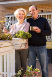 Smiling retired couple in patio Stock Images