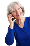 Smiling retired woman with mobile Royalty Free Stock Photo