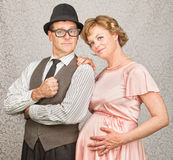 Smiling Retro Pregnant Couple Royalty Free Stock Images
