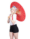 Smiling retro woman holding a red umbrella Stock Photos