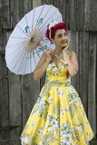 Smiling retro woman holding umbrella Stock Photos