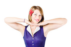 Smiling retro woman showing lipstick makeup Stock Photography